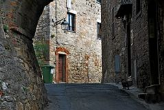Radicofani. Tuscany Italy square  sky windows cloud tower colors country road street courts green door panorama sunset courts cat sleep Royalty Free Stock Images