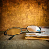 Rading glasses and newspaper Royalty Free Stock Photography
