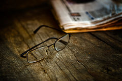 Rading glasses and newspaper Royalty Free Stock Images