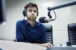 Radio anchorman hosts the program Royalty Free Stock Images