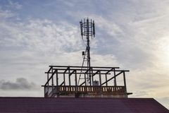 Radio antenna,cranes at sunset stock images