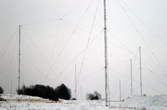 Radio Antenna Field in Winter. A view of several tall radio antennas or towers in Frederikshavn, Denmark.  Photo taken in winter with snow on the ground Royalty Free Stock Photo