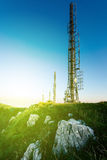 Radio antenna on mountain top Stock Images