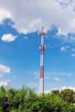Radio antenna over blue sky stock photography