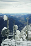 Radio antennae and on Zugspitze. Radio antennae and microwave dishes on the top of the Zugspitze mountain in Bavaria royalty free stock image