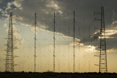 Radio antennas network at sunset Stock Image