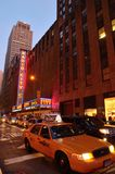 Radio City Hall and Taxis. Taxi Cabs at Radio City Music Hall Royalty Free Stock Photos
