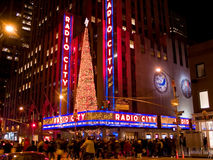Radio City Music Hall. Large crowds are all around Rockefeller Center and Radio City Music Hall during the holidays Stock Photos