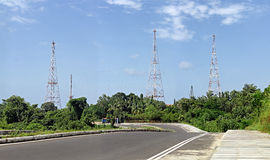 Radio Communication Antennae Towers. Cluster of radio communication antennae towers, along the road highway side royalty free stock photos