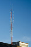 A radio communications tower against blue sky Stock Photo