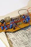 Radio components and the electrocircuit 3. The electrocircuit and the details of a radio receiver prepared for repair Stock Photography
