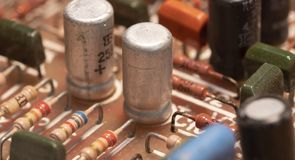 Radio components on a printed circuit board. Photo Close-up royalty free stock photo