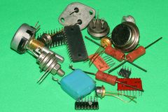 Radio components of the seventies and eighties. Both discrete elements and microchips are presented. The background is green stock images