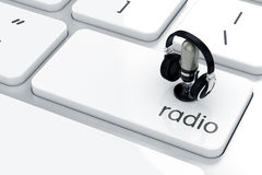 Radio concept. 3d render of microphone with headphones icon on the keyboard. Radio concept Royalty Free Stock Photography