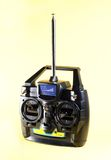 Radio control. A radio control on yellow background Royalty Free Stock Image