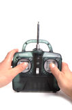 Radio control. Photograph of a radio control unit and human hands Royalty Free Stock Photography