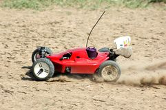 Radio Control Car. Radio controlled car spinning on the dirt royalty free stock image