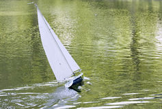 A radio control toy yacht sailing Royalty Free Stock Photography