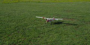 Radio controlled airplane in the grass stock photos