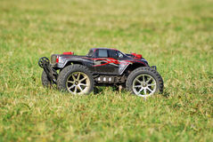 Radio controlled car. 1/10 scale radio control monster truck are big, fast and simple. Powered by powerful dual electric motors, these remote controlled monster royalty free stock images