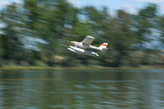 Radio controlled hydroplane taking off Stock Images