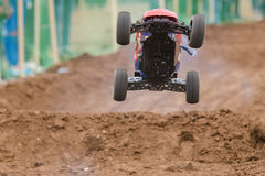 Radio-controlled machine with a combustion engine has jumped on the trampoline Royalty Free Stock Images