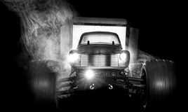Radio Controlled Monster truck in Black and White. A radio controlled toy 10/10 scale monster truck similar to a 1050s Chevy pick up is shown backlit in black royalty free stock images