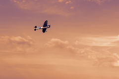 Radio controlled toy airplane at sunset. RC model airplane flyin royalty free stock photo
