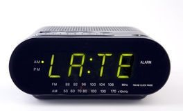 Radio d'horloge avec le mot TARD photo stock