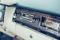 Radio in dashboard in interior of old vintage automobile. Royalty Free Stock Photo