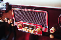 Radio in dashboard in interior of old vintage automobile. Stock Images