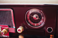 Radio in dashboard in interior of old vintage automobile. Royalty Free Stock Photos