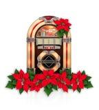 Radio de la máquina tocadiscos con el ornamento rojo de la Navidad de la flor de la poinsetia Imagenes de archivo