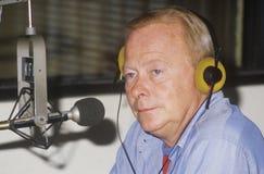 Radio disc jockey. For station KFI in his studio, Los Angeles, CA stock images