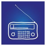 The radio hand-drawn on a blue background. With white color royalty free illustration