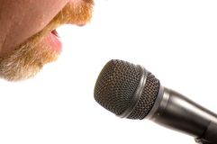 Radio Host. Bearded man speaking into a microphone with only cheeks and mouth visible. Isolated on white background Stock Photo