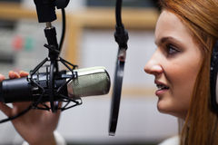 Radio host speaking. Through a microphone Royalty Free Stock Photos