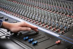 Radio host working with mixer. In studio Royalty Free Stock Photos