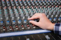 Radio host working with mixer. In studio Stock Photography