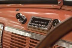 Interior of old vintage automobile. Radio in interior of old vintage automobile Stock Photos