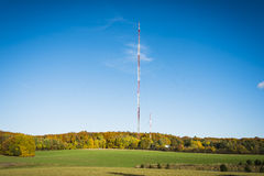 Radio mast on a background of blue sky . Stock Photo