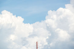 A radio mast with the cloud in background Stock Image