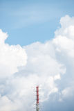 A radio mast with the cloud in background Stock Photos