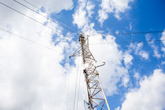 An radio mast. On a tall building there is a radio mast Stock Photo