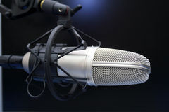 Radio mic. On dark blue background