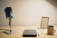Radio microphone with diary, cup of coffe and blank picture frame, mock up royalty free stock images