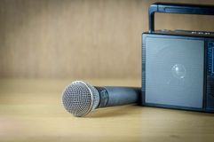 Radio and microphone on table. Stock Photos