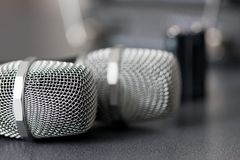 Radio microphones. wireless sound transmission system. soft focus. Two mics royalty free stock photos