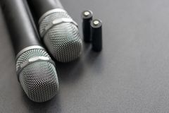 Radio microphones. wireless sound transmission system. soft focus. Two mics and batteries royalty free stock photo
