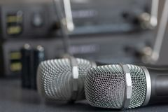 Radio microphones. wireless sound transmission system. soft focus Two mics.  royalty free stock image
